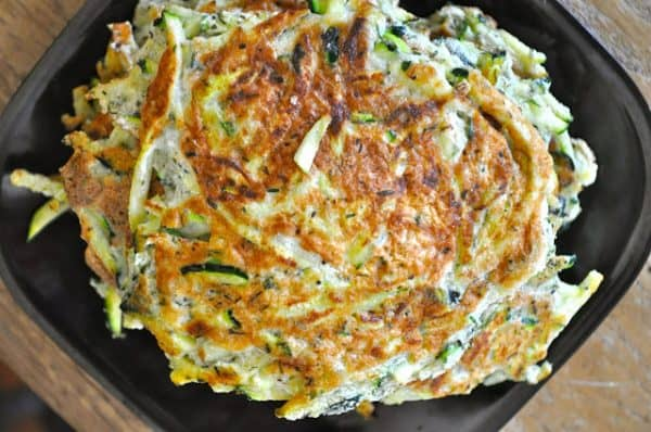 I love thesePaleo Zucchini Fritters. Not only do they get my kids to chow down on zucchini, always abundant in Alaska garden but they also make a perfect side dish. I don't know about you but whenever I go Paleo I'm gung ho and then I'm ho-hum.I need something new and exciting because I get tired of M E A T. #paleo #lowcarb #keto #vegetarianlowcarb #lowcarbrecipes #lowcarbrecipe #lowcarbsnacks