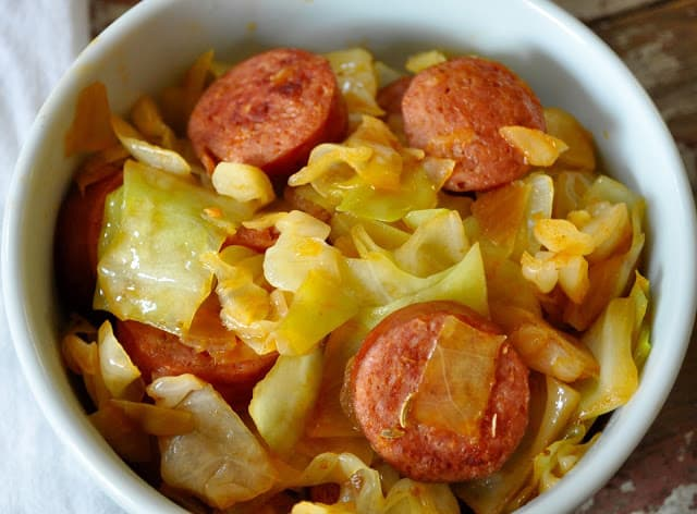 This recipe for Smothered Cabbage with Smoked Sausage was something I was pointed towards a few years ago when I was inundated with bountiful cabbage. #cabbagerecipe #southerncabbage #cabbagerecipes #quickdinnerrecipes #dinnerrecipe