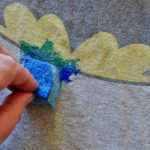 sponge painting the earth on a shirt