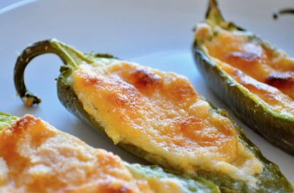 This recipefor Baked Jalapeño Poppers has it ALL going on. First it's LOW CARB but then it has cheddar cheese,smooth cream cheese, crispy topping, all served up in ajalapeño. And you can make them in your OVEN. #keto #lowcarb #lowsugarrecipes #lowsugarsnacks #lowsugartreats #lowsugardiet #ketosnacks #ketorecipe #jalapenopopper #bakedjalapenopopperrecipe #lowcarbsnacksforthebiggame