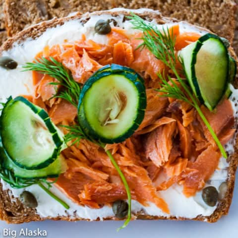 perfect Smørrebrød with salmon cream cheese dil capers and cucumbers--an open face sandwich