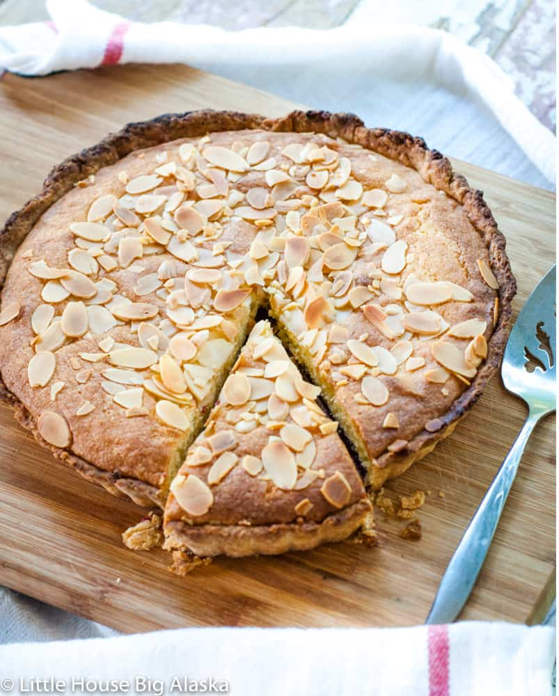 bakewell tart with a slice out of it