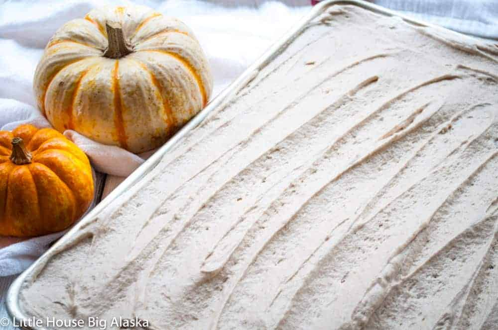 cinnamon icing on a pumpkin sheet cake