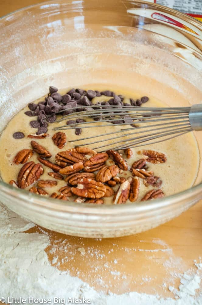 chocolate pecan pie being mixed together