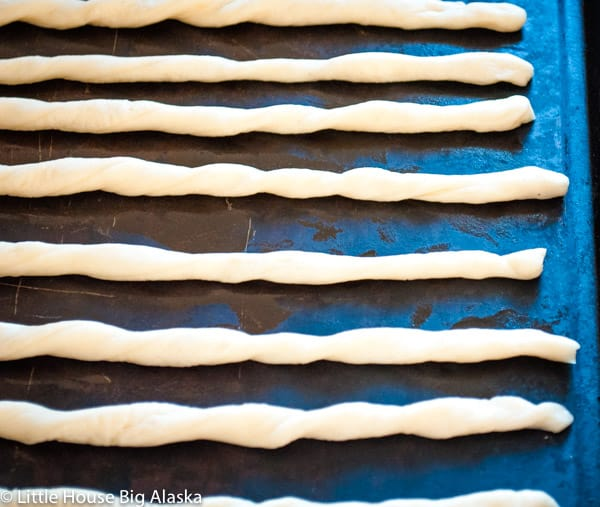 rolled crispy italian breadsticks ready for the oven