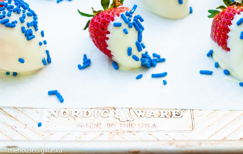 These FUN Red, White, and Blue Strawberries are simply white chocolate covered strawberries made into a beautiful Patriotic Dessert!