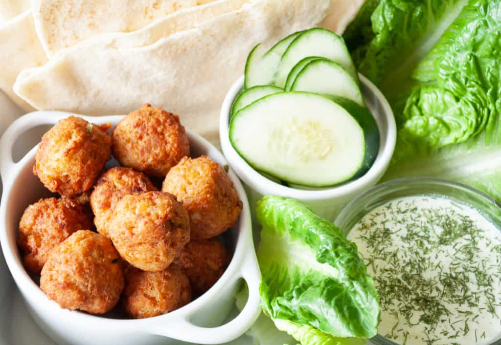 all the toppings for a fresh falafel sandwich