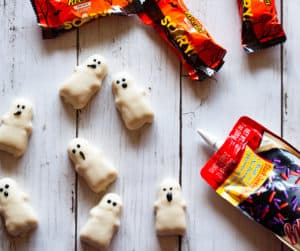 Making faces on Reese's Peanut Butter Ghosts