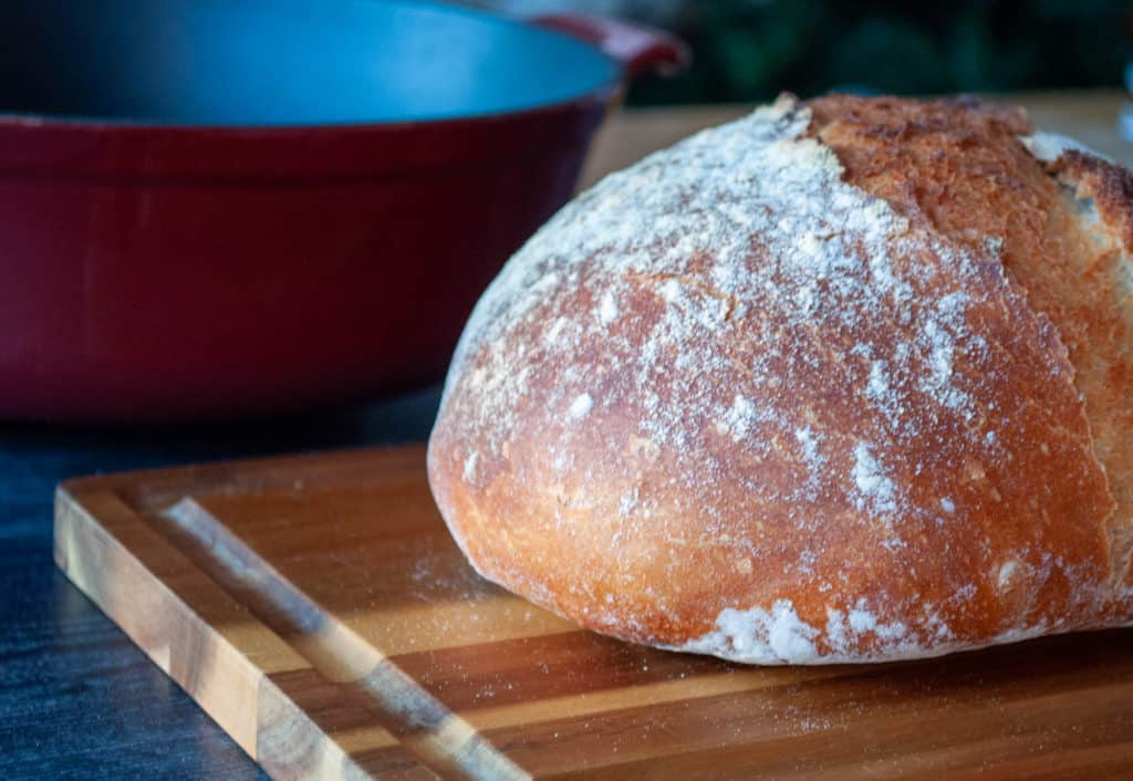 A round loaf of rustic bread.