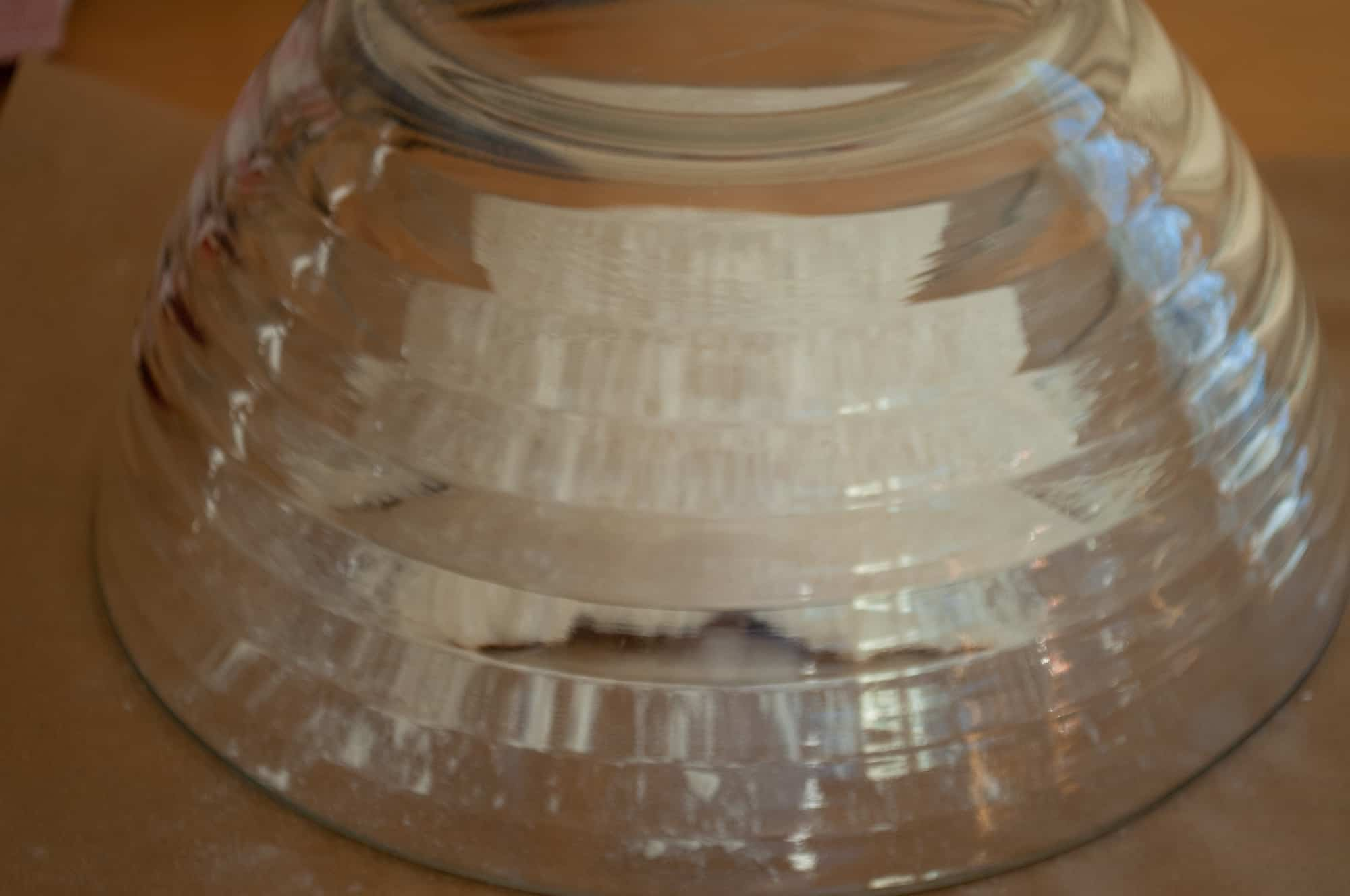 Letting bread rise under a bowl reduces the need for plastic wrap.