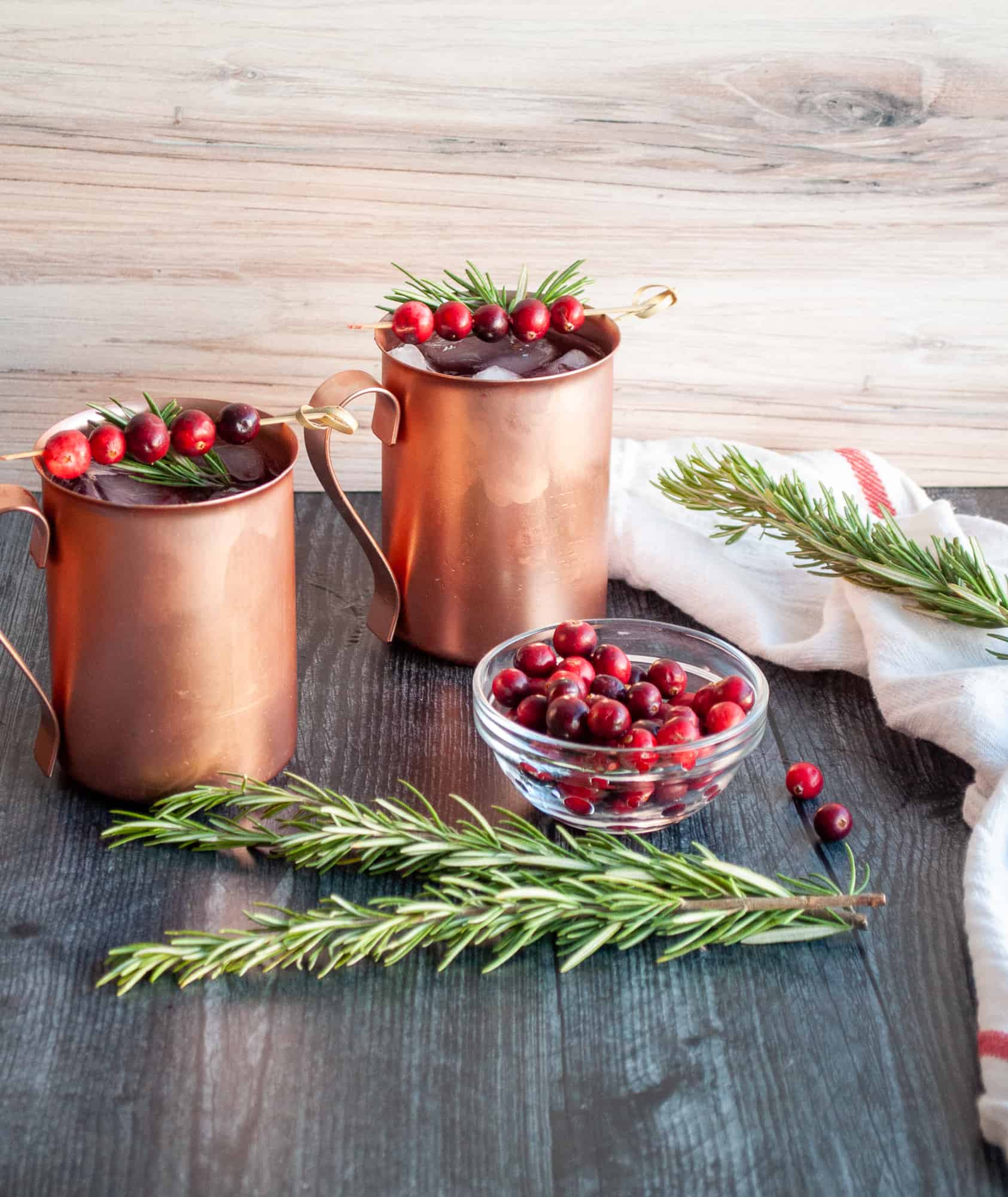 Refreshing christmas cocktails in copper mugs.