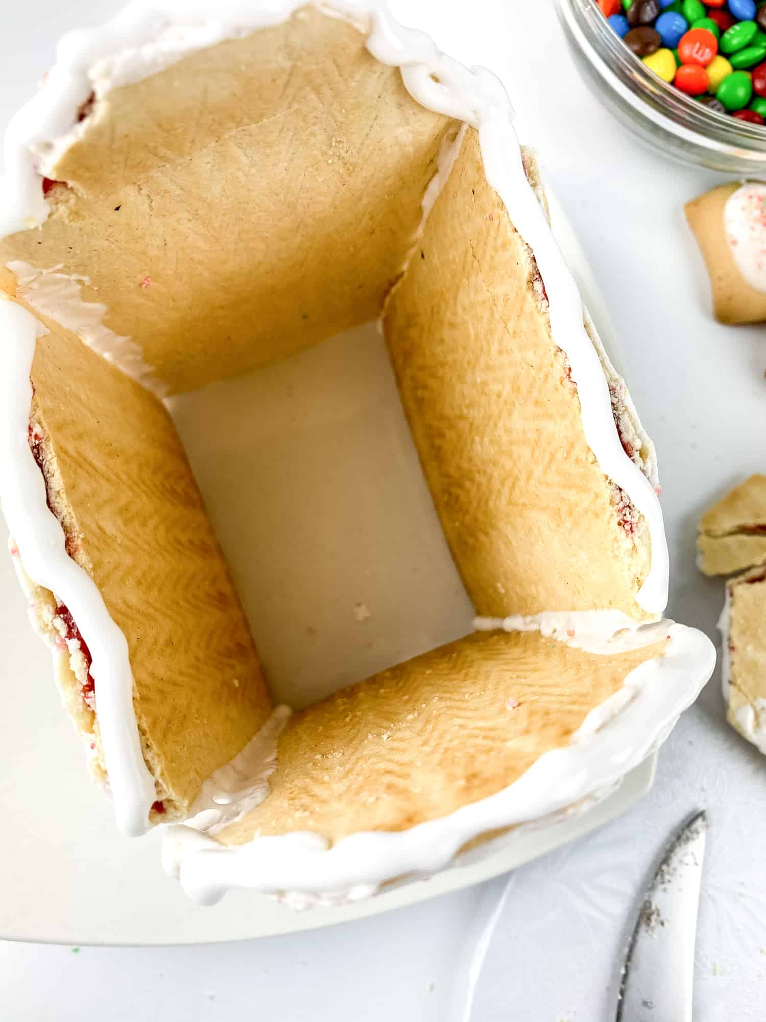 Adding the roof to your no-bake gingerbread house.