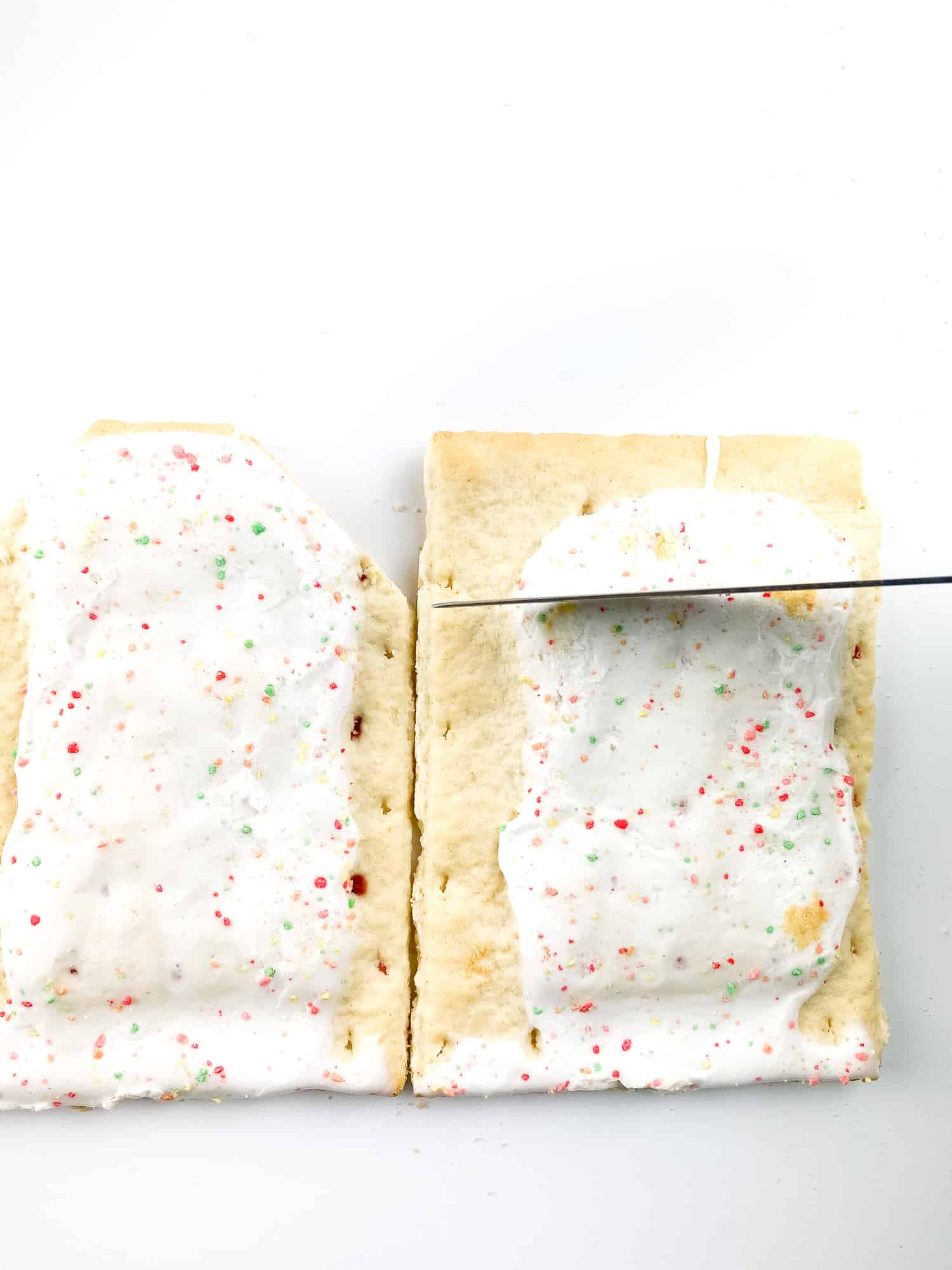 Making walls out of pop-tarts for the no-bake gingerbread house.