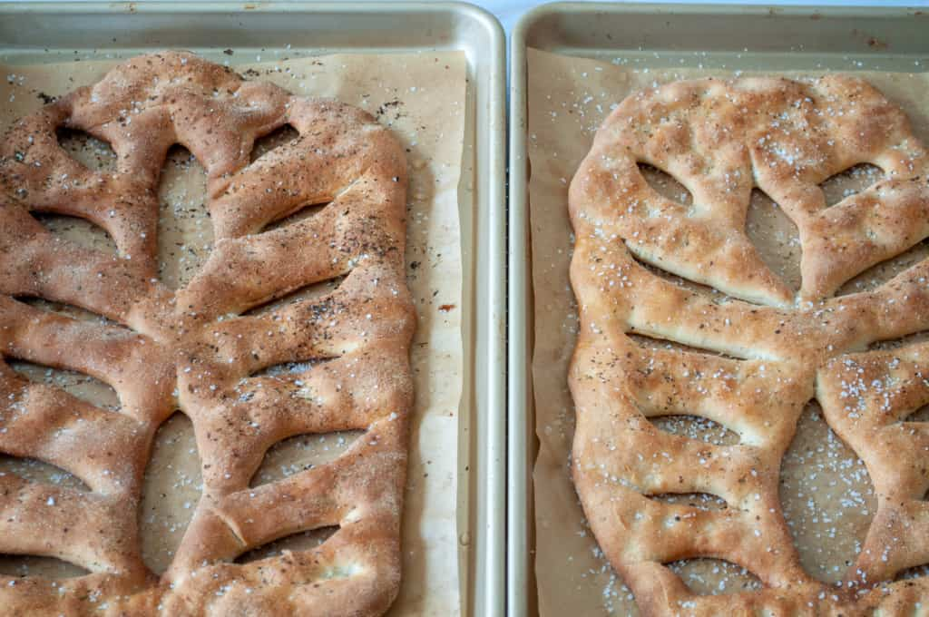 Fresh leaf shaped bread on baking sheets with parchment paper.