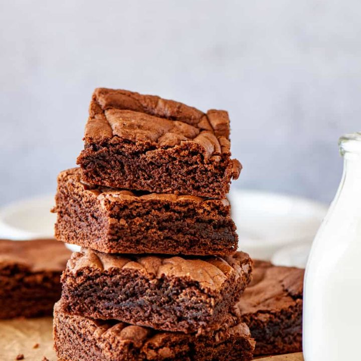 Stack of Cake Mix Brownies with milk.