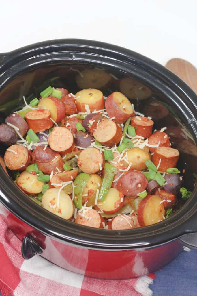 Sausage and potatoes in the slow cooker.