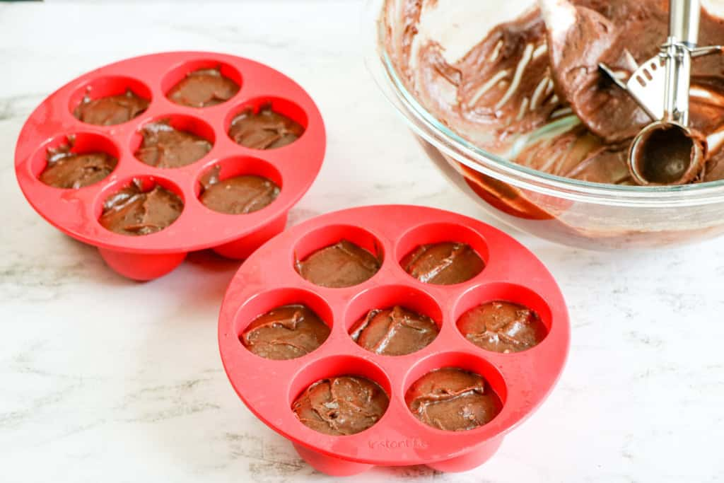 Egg bite molds filled with fudgy brownie batter.