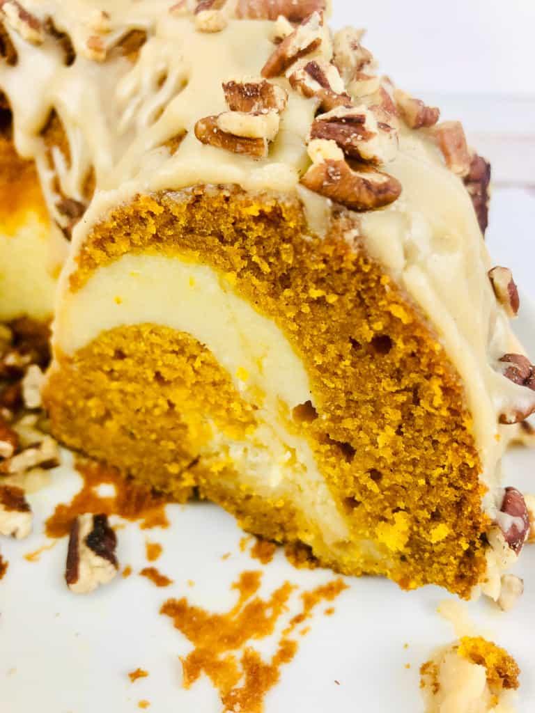 Sliced bundt cake with cream cheese swirl.