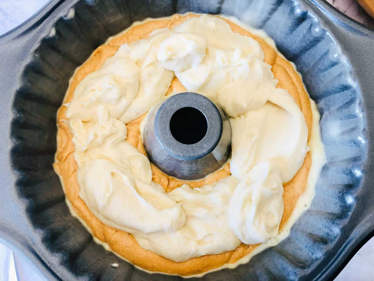 Cream cheese filling on a bundt cake.