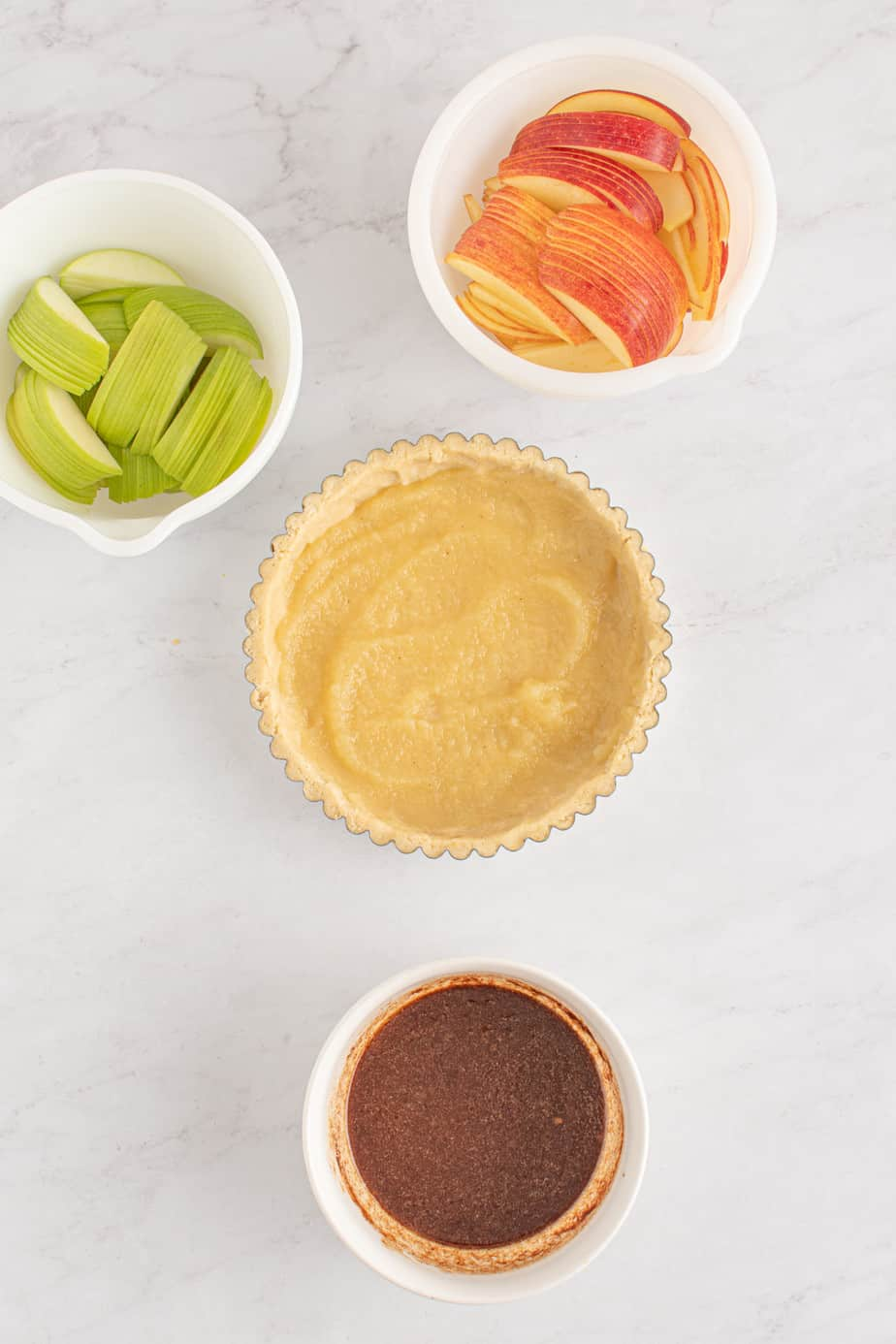 Filling the apple tart.