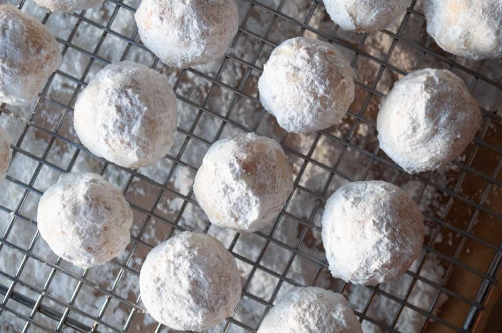 Freshly rolled snowball cookies.