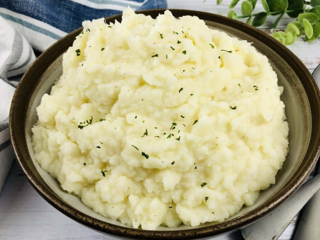 A serving bowl of Instant Pot Mashed Potatoes.